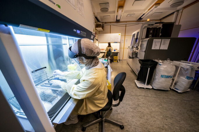 Here, a bioengineer tests samples for SARS-CoV-2 in an analysis machine at the clinic for laboratory medicine at Oslo University Hospital Ullevål.