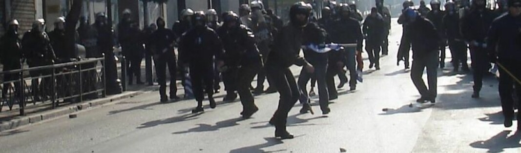 Golden Dawn activists and Greek riot police in February 2008.