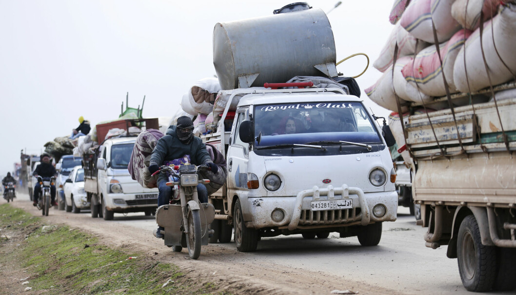 Syrians fleeing the advance of the government forces in the province of Idlib, Syria, towards the Turkish border in January 2020.