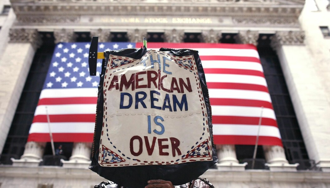 A protester outside the New York Stock Exchange expresses his loss of faith in the American dream.