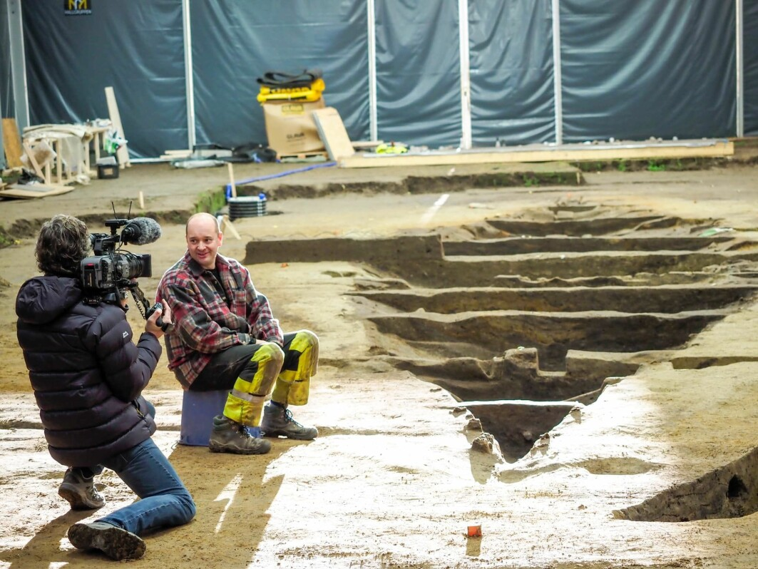 The Gjellestad Viking ship dig has been visited by numerous Norwegian and international media, politicians and Viking fans throughout the excavation. The Norwegian national broadcaster NRK even broadcast a live five day stream from the dig. Pictured here is Pierre Stine, director of a French documentary about the ship, interviewing Christian Løchsen Rødsrud, project manager for the entire excavation.