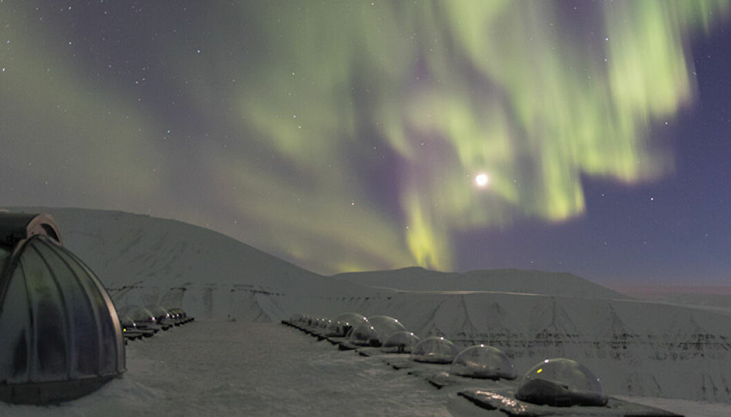 The northern lights - the aurora borealis - seen above the Kjell Henriksen Observatory on Svalbard, high in the Arctic.