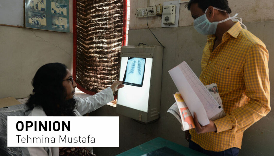 A doctor checks the chest X-ray of a patient in the tuberculosis department of the government-run Osmania General Hospital in Hyderabad.