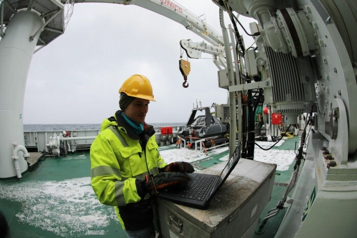 Jens Einar Bremnes programming the USV prior to the mission setting up the data collection software for light measurements.