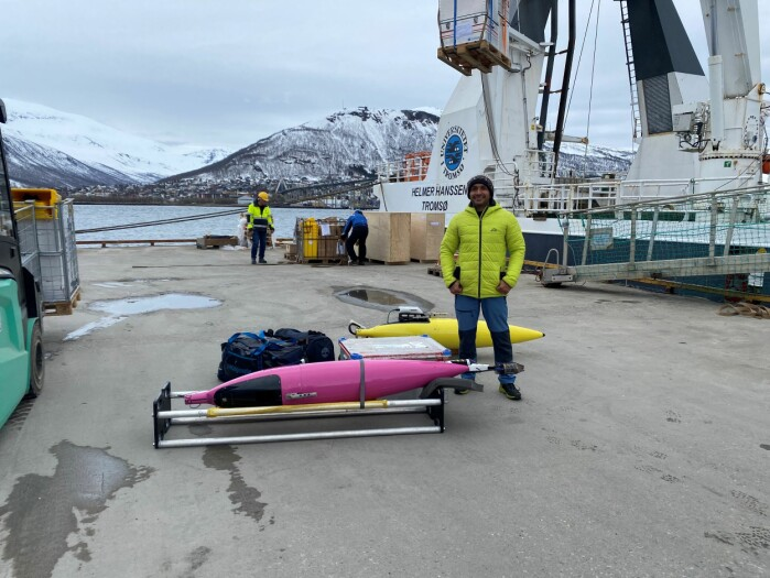 Ahsan Abdi, technician, posing in front of the gliders that'll join the researchers on their expedition.