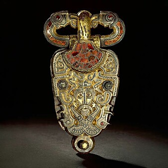 Half human, half wild boar. Eagle heads are seen on each side of the man's face, and two eagles form the belt itself. Belt buckle from Åker in Hedmark.