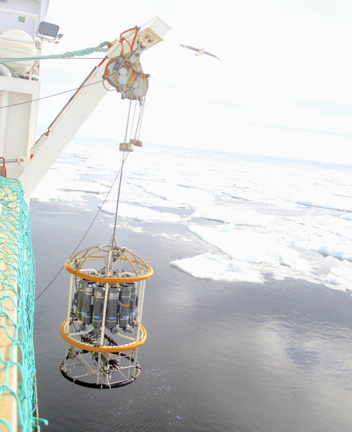 CTD lowered into the waters next to the sea ice.