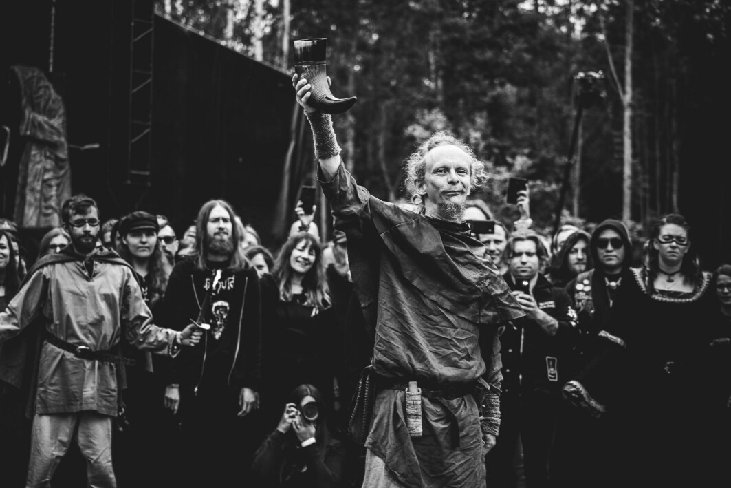 Gustav Holberg from the folk music group Folket Bortafor Nordavinden (the People Beyond the Northwind) holds his drinking horn up high during the opening ceremony of the extreme metal and Viking Age festival Midgardsblot. The festival attracts thousands of people from all over the world annually since 2014.