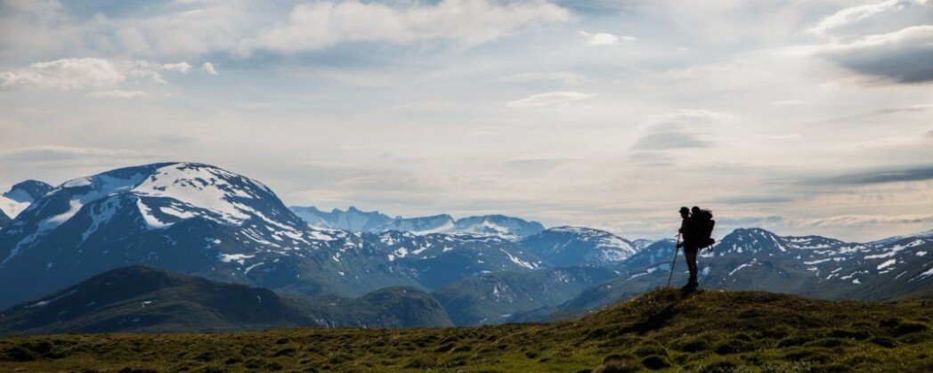 Reidar Marstein standing in front of the mountains between Neto and the western fjords.